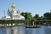 Magnificent church on background of water and fountains in Peterhof Magnificent church on background