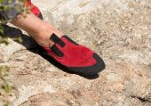 Close Up Of Red Rubber Climbing Shoe On Rock