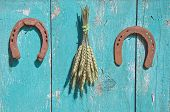 Wheat Bunch And Two Horseshoe Luck Symbol On Wooden Barn Wall