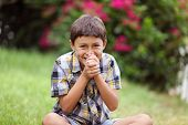 Young boy sitting outside