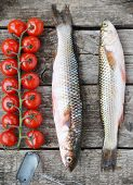image of mullet  - raw mullet with cherry tomatoes on wooden table - JPG