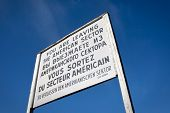 Sign At Checkpoint Charlie That Divided East And West Berlin