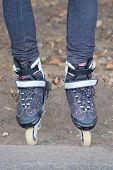 the image of a roller blades  on the legs of child