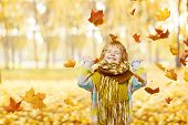 Child Portrait In Autumn Park, Smiling Little Kid Happy Playing With Falling Yellow Leaves