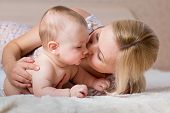 Loving Mother Kissing Her Baby