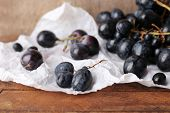Purple grape on wooden background