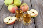 Still life with tasty apple cider in barrel and fresh apples