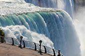 image of binoculars  - American side of Niagara falls and binoculars - JPG