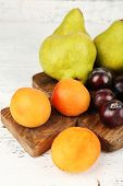 Ripe fruits on table on wooden background