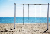 Two Hanging Swing On A Beach