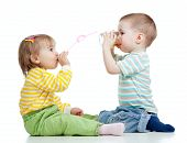 Boy And Girl Drinking Juice From Glass