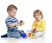Little Children Playing With Colorful Toy Over White Background