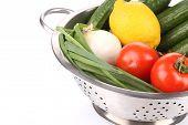 Vegetables in colander.
