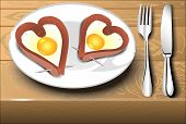 Scrambled Eggs With Sausage In A Heart Shape On A White Plate