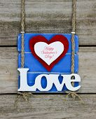 Happy Valentine's Day and Love text on blue wood sign
