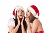 Two Young Women In Santa Costume.