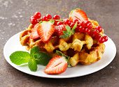 homemade Belgian waffles with berries (currants and strawberries)
