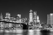 picture of bridge  - The Manhattan skyline and Brooklyn Bridge at night seen from Brooklyn Bridge Park in Brooklyn New York - JPG