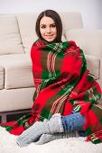 Woman At Home Wrapped in Plaid Blanket