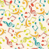 Colorful musical notes and headphone on beige background.
