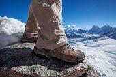 Hiking Boot Closeup On Mountain Rocks