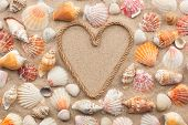 Symbolic Heart Made From Rope And Seashells Lying On The Sand