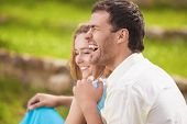 Portrait Of Happy Laughing Caucasian Couple Having Fun Outdoors And Embracing