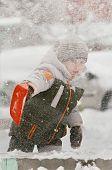 boy Playing in Fresh Snow