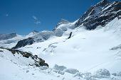Snow And Peaks Nearby Jungfraujoch In Switzerland