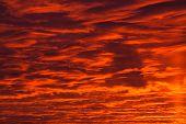 Dark Cloud On Red Sky