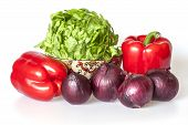 Two large red peppers, red onions and bunch of fresh salad