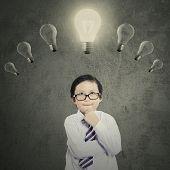 Schoolboy Under Bright Lightbulb