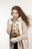 pretty woman with vintage telephone on grey