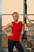 Athletic woman trx