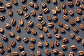 top view of coffee beans on black background