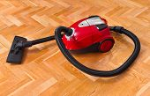 Vacuum cleaner on parquet - technology housework