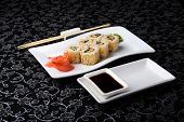 California Rolls Sushi With Pickled Ginger,vasabi And Soy Sauce In The Plate