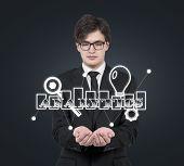 Businessman Holding Analytics Symbol