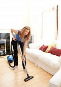 Unhappy Woman With Vaccum Cleaner
