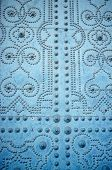 stock photo of stud  - Detail take of an old door studded with geometric motives - JPG