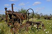 Wheels missing on old tractor