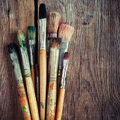 Bunch Of Old Artist Paintbrushes On Wooden Rustic Table