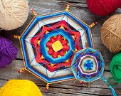 Two Knitted Tibetan Mandala From Threads And Yarn On Wooden Rustic Table, Top View