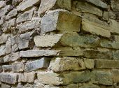 stock photo of mortar-joint  - Stone masonry corner with rich and various texture - JPG