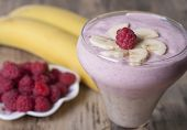 Cocktail Of Banana And Fresh Raspberries With Yogurt