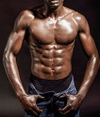 Athletic Black Man On Black Background