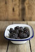 Blackberries In Rustic Kitchen Setting With Wooden Background
