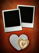 polaroid style photo frames on corkboard with paper heart