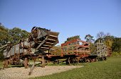pic of threshing  - The tolls  needed for harvest of years ago are the parked threshing machine - JPG