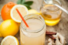 picture of cold drink  - Healthy drink with lemon cinammon ginger and honey to prevent cold - JPG